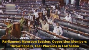 Opposition members throw papers,